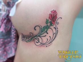 Under chest Rose Tattoo by Wake up Tattoo Phuket