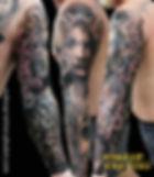 アメリカンスタイルのフルアームのタトゥー