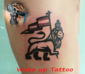 Logo tattoo by Wake up Tattoo Phuket