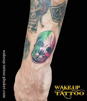 Skull in colors of the Italian flag by Wake up Tattoo Phuket