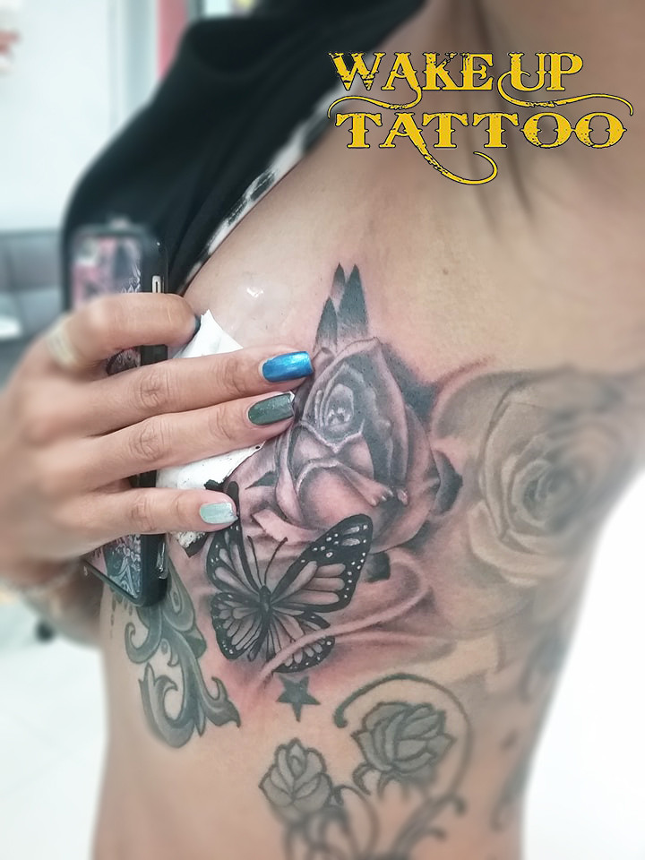 Sexy Butterfly chest side Tattoo in Tattoo Phuket Studio