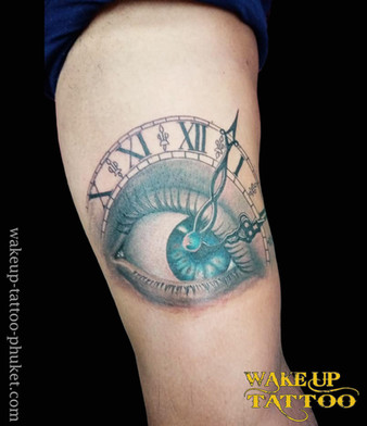 Eye with clock tattoo by Wake up Tattoo Phuket