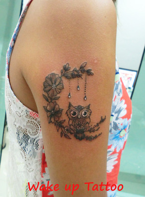 Tiny owl tattoo by Wake up tattoo in Patong