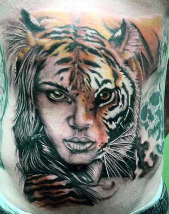 Tiger and Woman half face tattoo by Wake up Tattoo Phuket