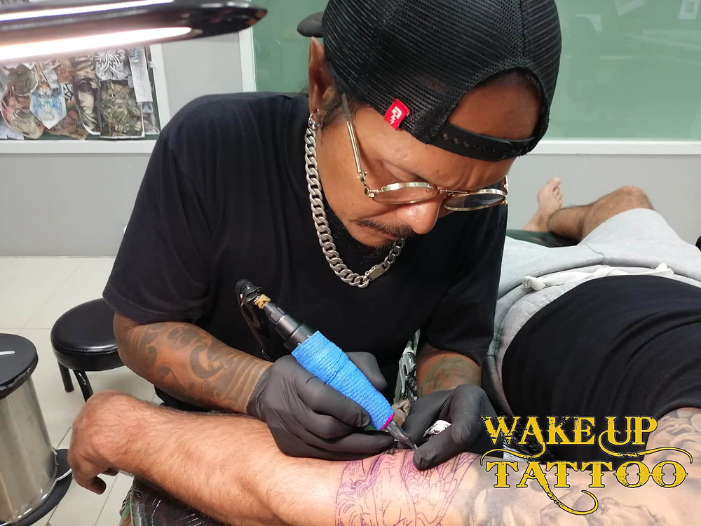 Artist by Ouner of Wake up Tattoo