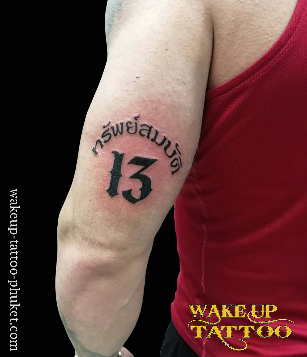Thai character tattoo with No,13 by Wake up Tattoo.