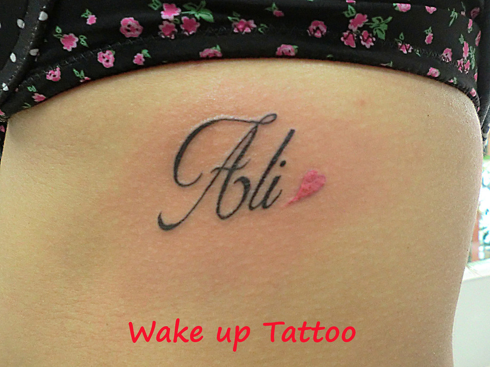 Love tattoo by Wake up Tattoo Phuket