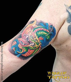 Thai Dragon tattoo by Wake up Tattoo Phuket