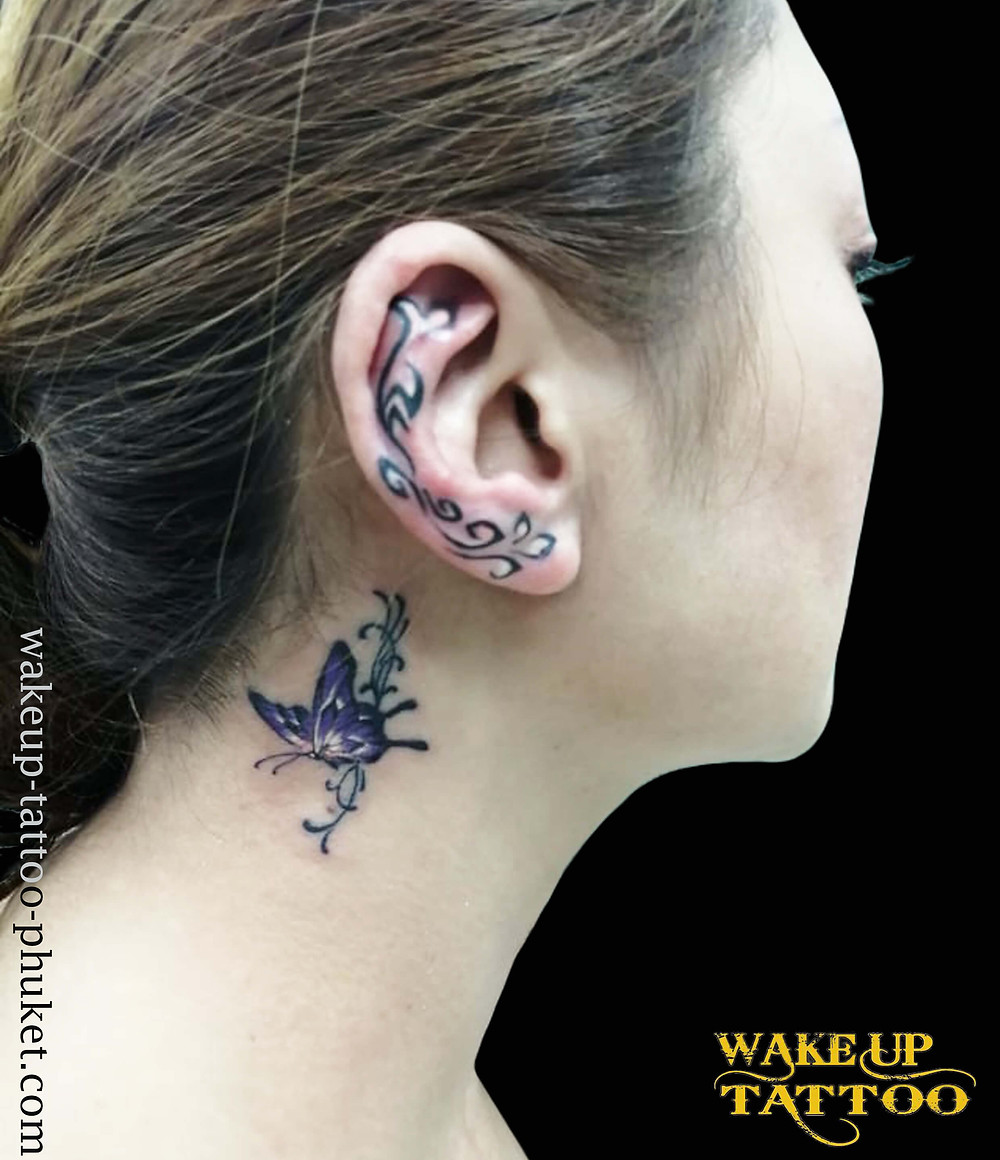 Ear tattoo with Butterfly tattoo by Wake up Tattoo Phuket