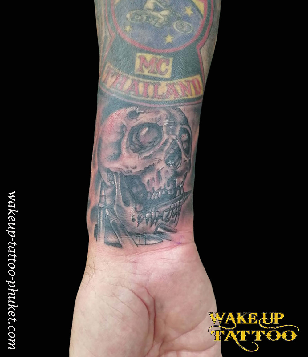 Skull small tattoo by Wake up Tattoo Phuket