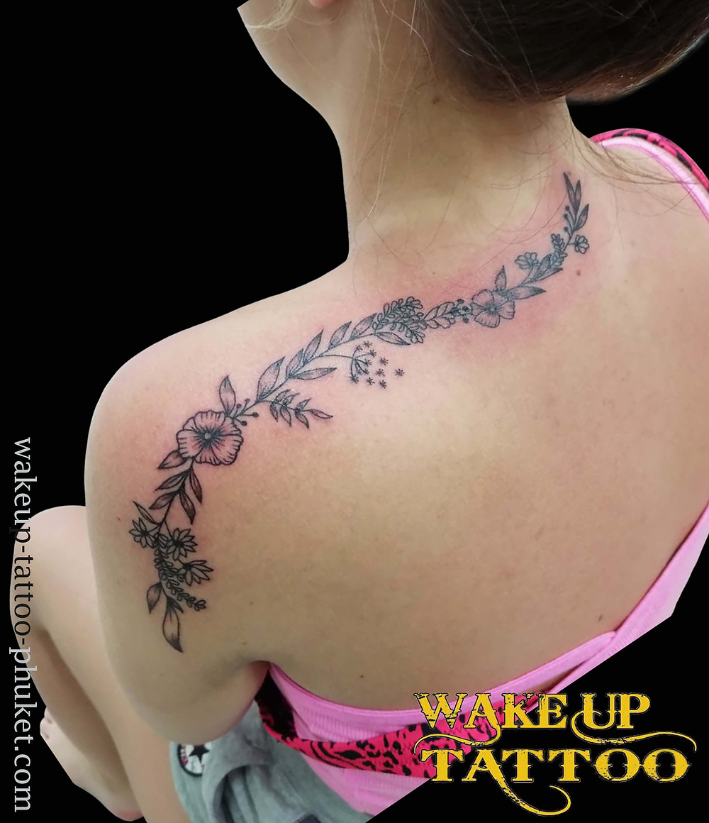 Flowers tattoo on shoulder by Wake up Tattoo Phuket