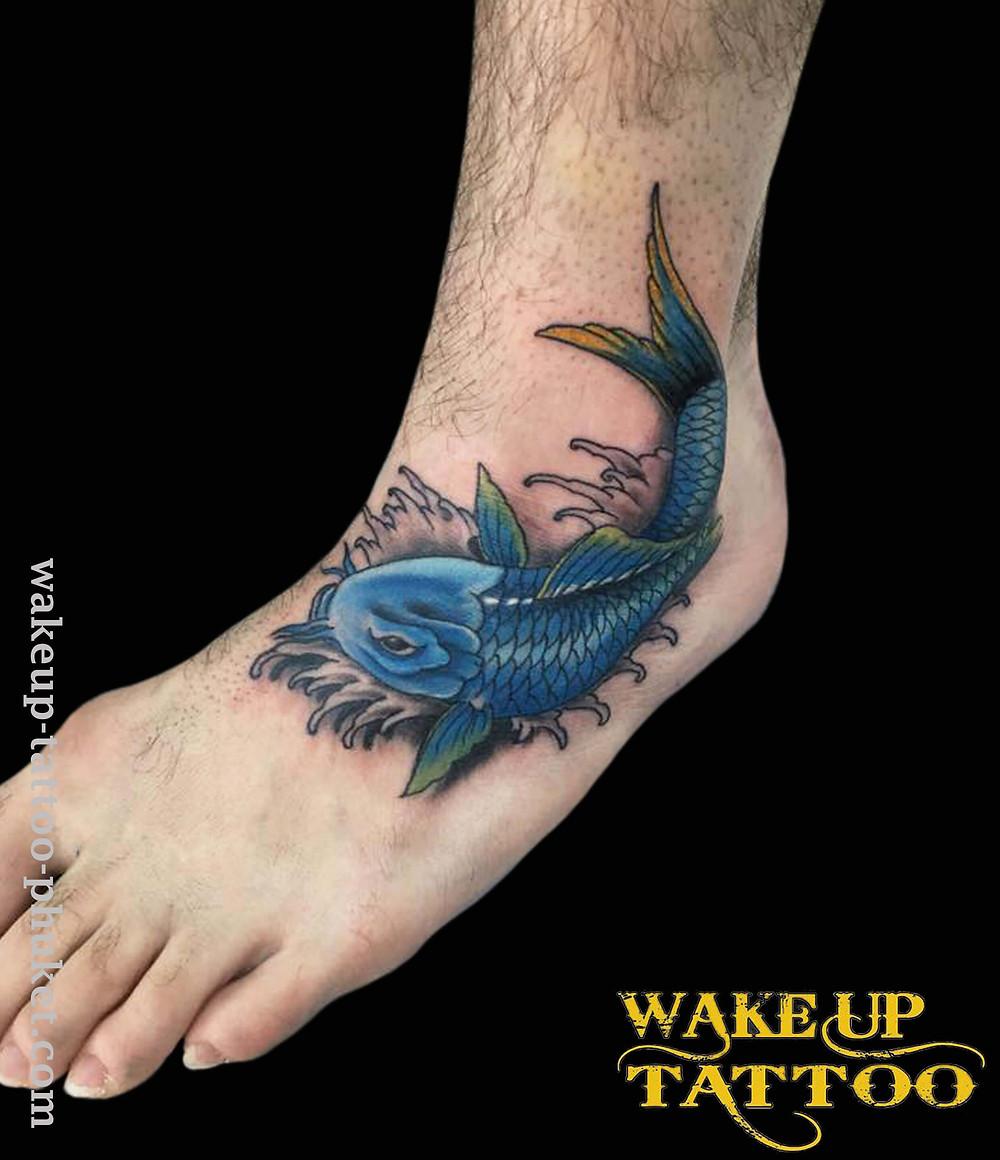 Koi fish tattoo on his instep at Wake up Tattoo Phuket
