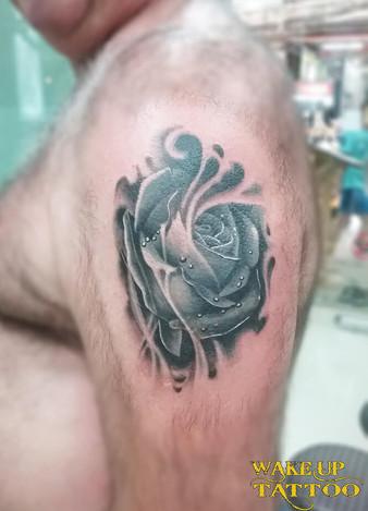 Black rose and water tattoo by Wake up tattoo Phuket