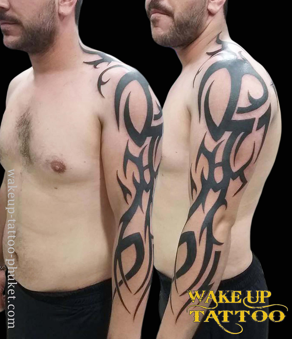 Tribal sleeve tattoo by Wake up Tattoo Phuket