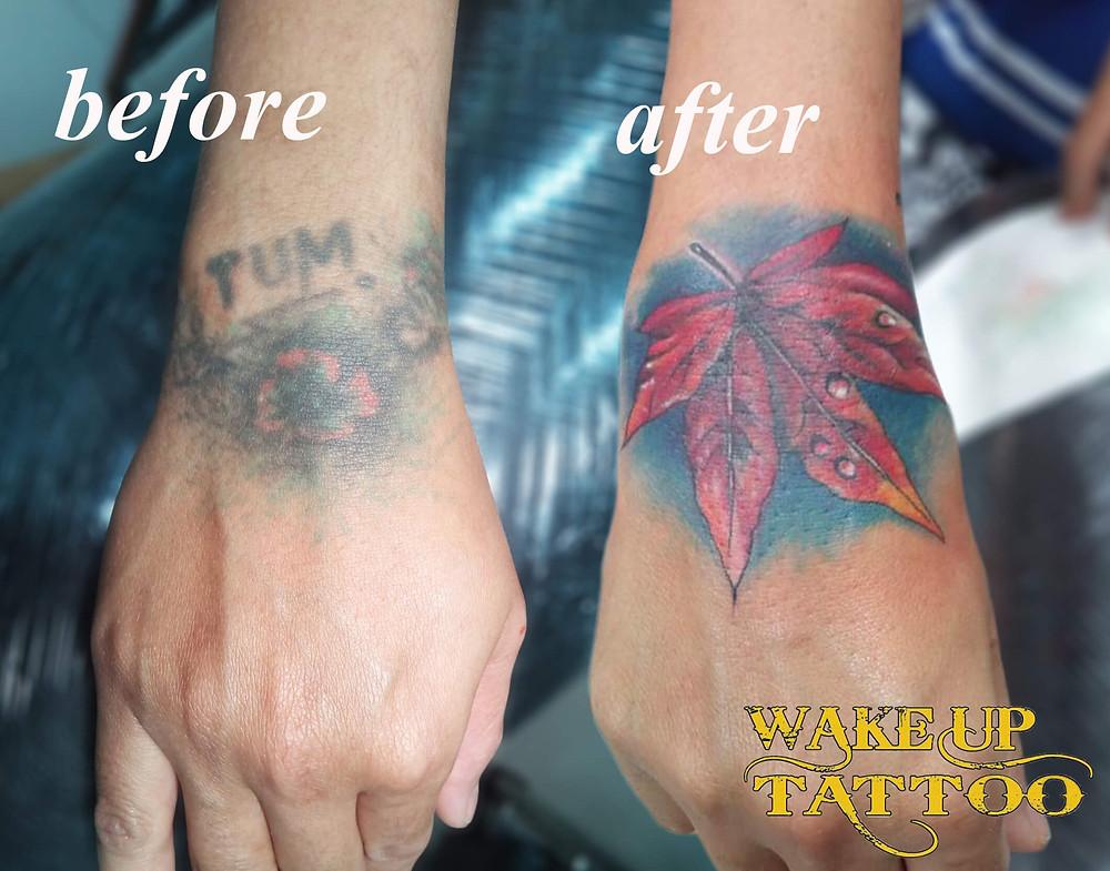 Cover up hand tattoo by Wake up Tattoo Phuket