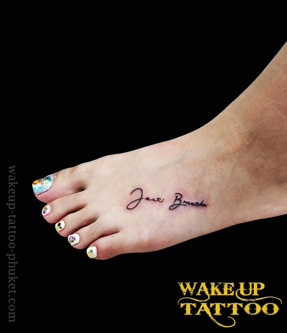 Instep tattoo by Wake up Tattoo Phuket