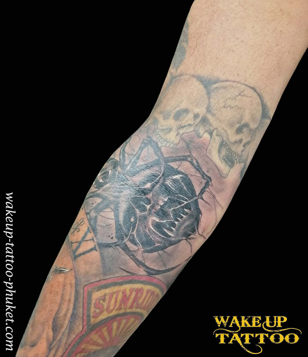 Skull spider tattoo by Wake up Tattoo Phuket