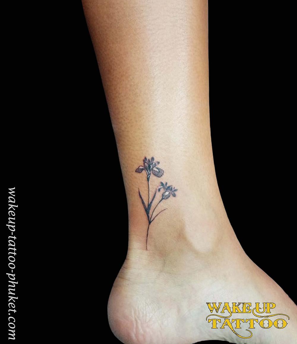 Iris flower tattoo by Wake up Tattoo Phuket