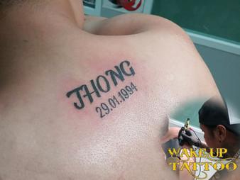 Name tattoo by Wake up Tattoo at Patong Beach Phuket Thailand