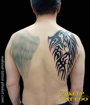 Tribal wing tattoo on the Back by Wake up Tattoo Phuket