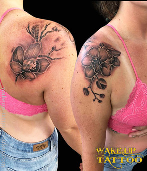 Flower tattoo on the shoulder by Wake up Tattoo Phuket