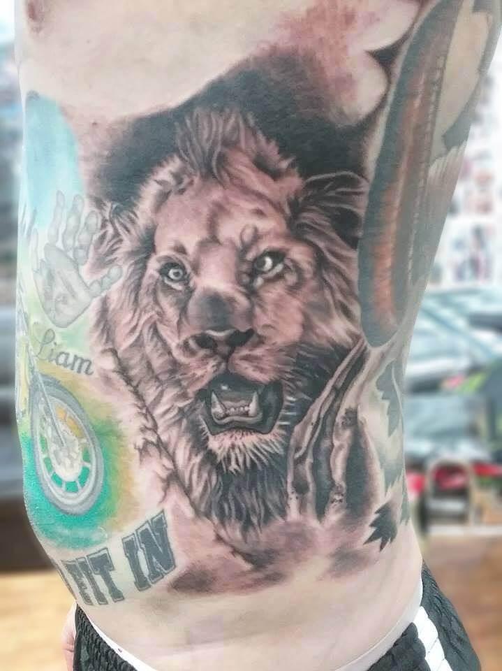 Lion Face Tattoo On Rib by Wake up Tattoo Phuket
