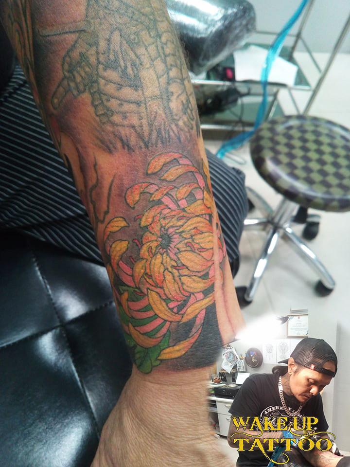 Lotus color tattoo by Wake up Tattoo Phuklet at Patong Beach Thailand