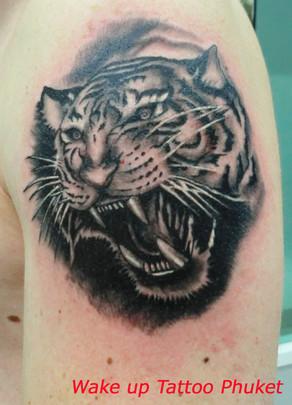 Tiger tattoo by Wake up Tattoo Phuket at Patong Beach