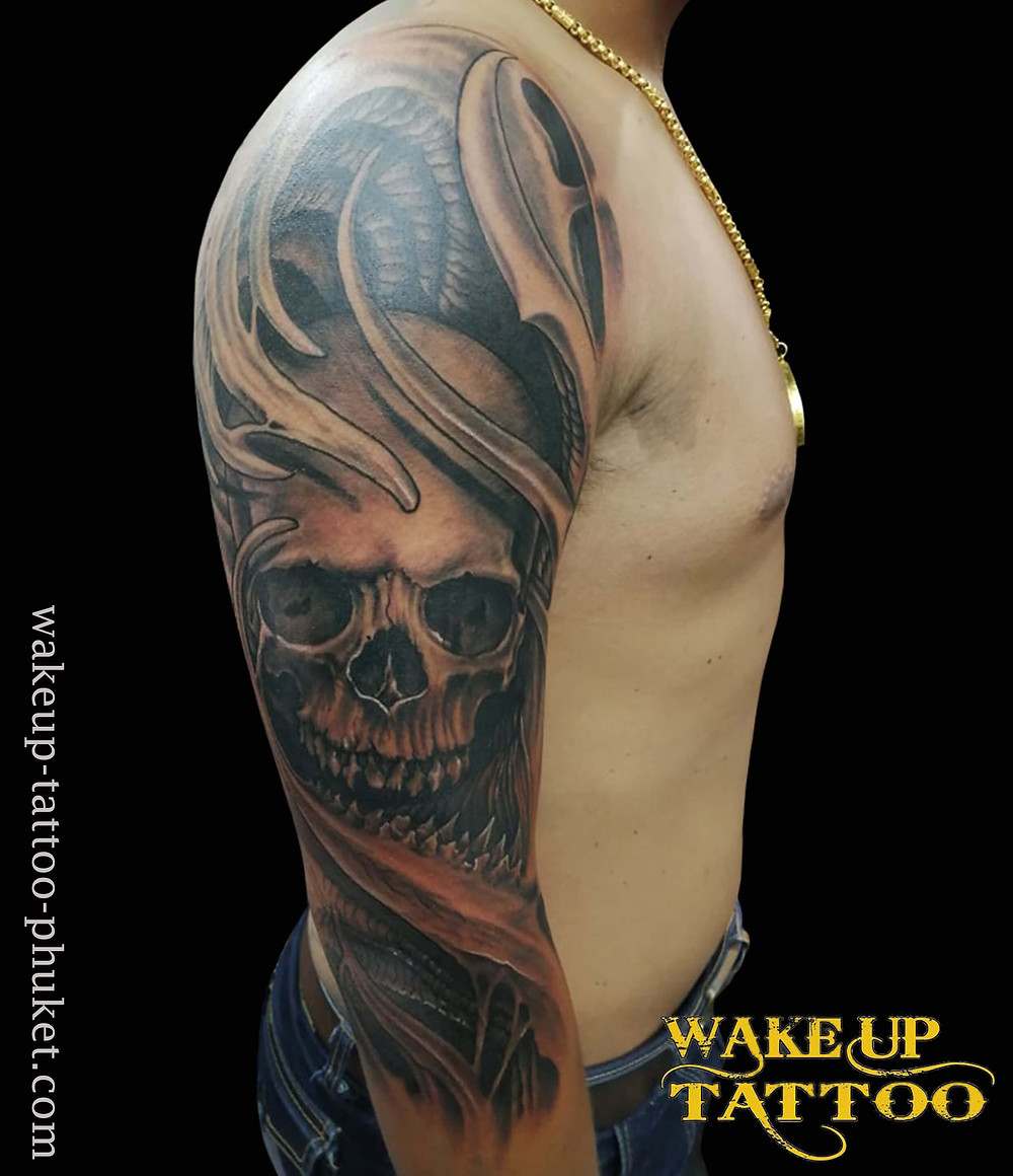 Skuii cool tattoo on the arm by Wake up Tattoo Phuket