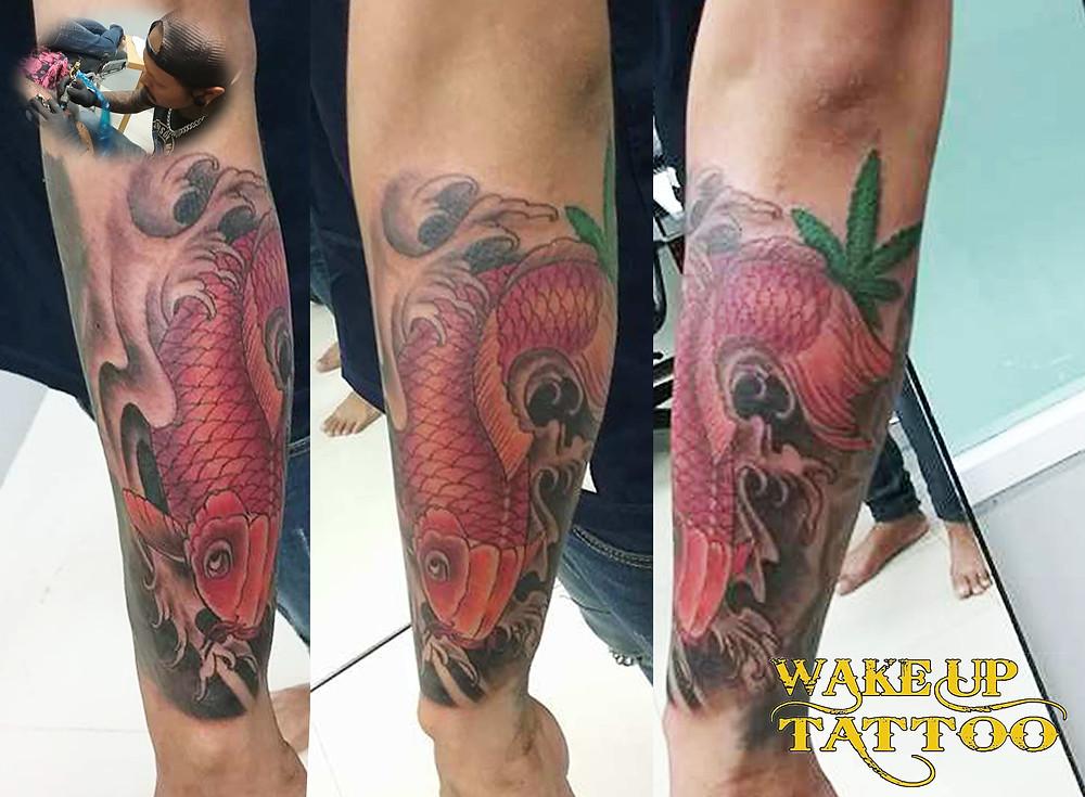 Japanese style fish tattoo by Wake up Tattoo Phuket