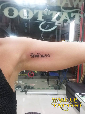Thai style character tattoo by Wake up Tattoo at Patong Beach Thailand