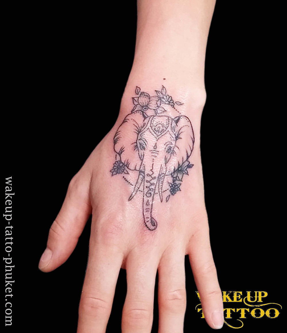 Small elephant tattoo on the hand by Wake up Tattoo Phuket