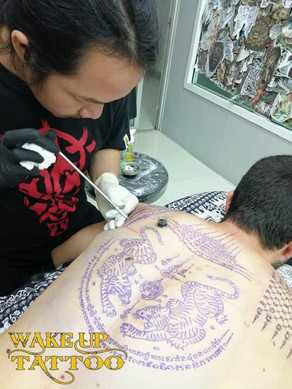 Traditional Thai Bamboo Tattoo by Wake up Tattoo Phuket