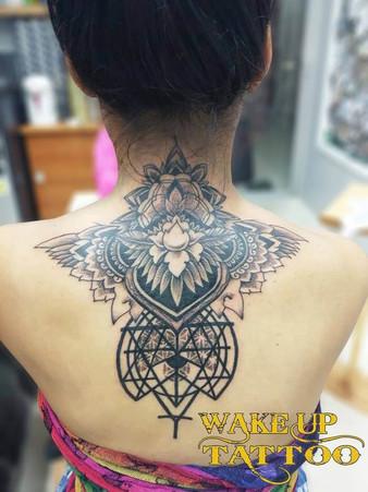 Geometric mandala tattoo by Wake up Tattoo Phuket