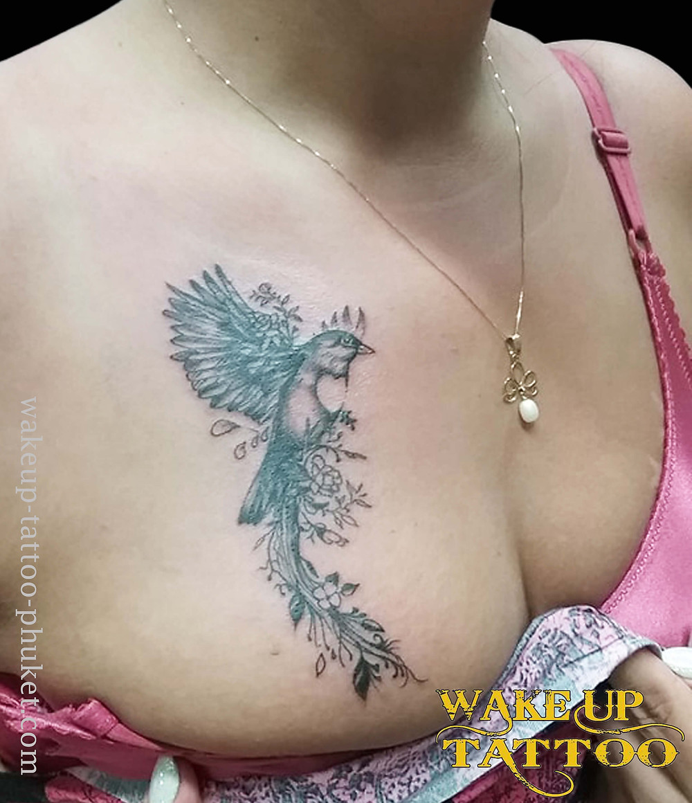 Bird with flower tattoo by Wake up Tattoo Phuket