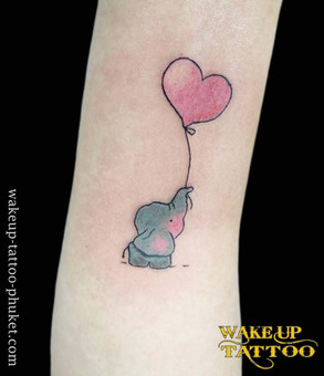 Small Elephant with heart tattoo by Wake up Tattoo Phuket