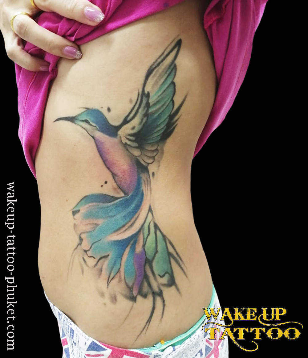 Water color bird tattoo by Wake up Tattoo Phuket