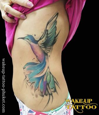 Water color bird tattoo by Wake up Tattoo Phuket