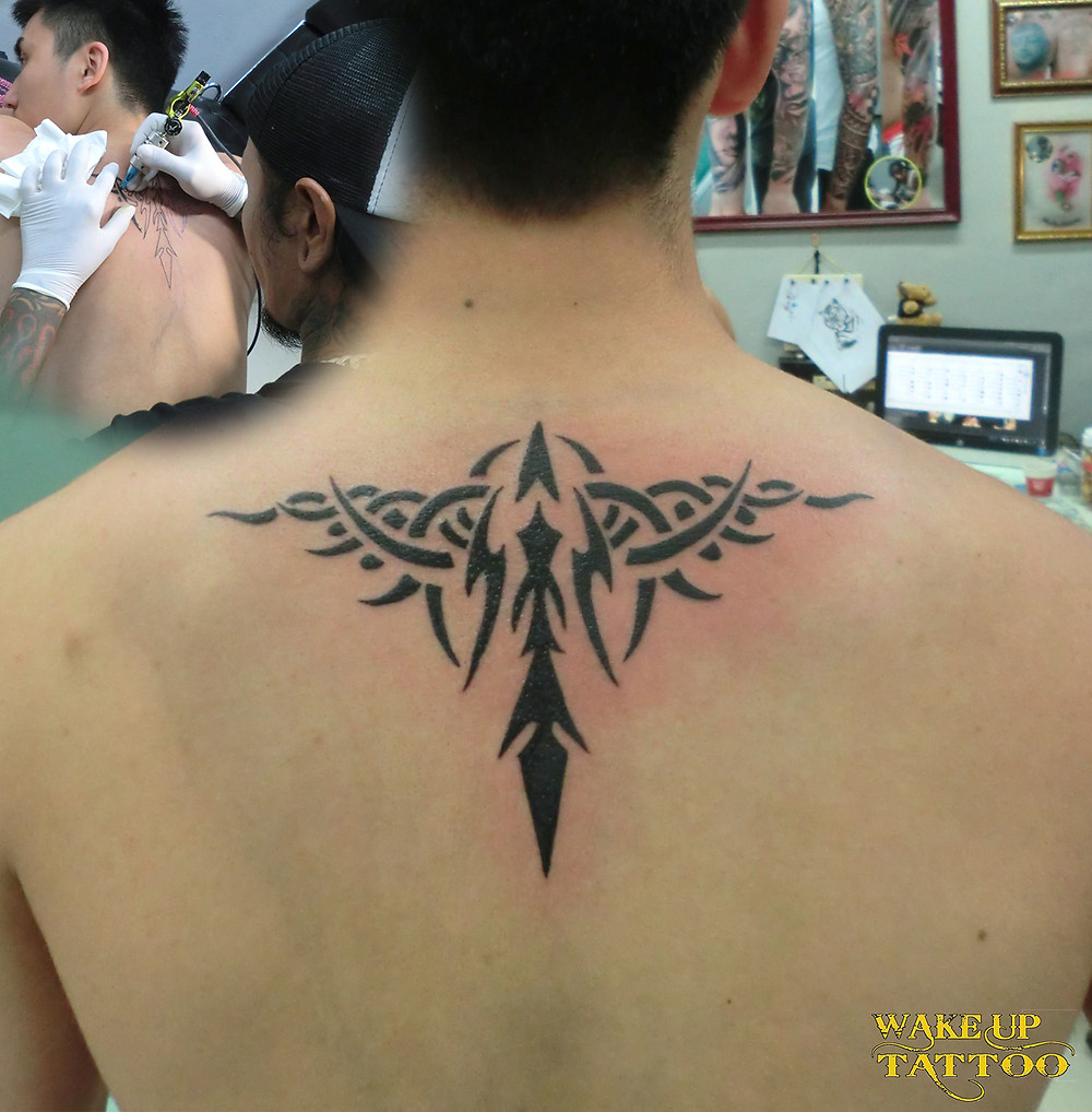tribal tattoo by Wake up Tattoo Phuket at Patong Beach