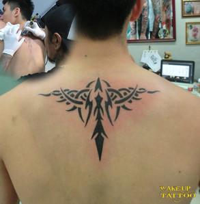tribal tattoo by Wake up Tattoo Phuket at Patong Beach