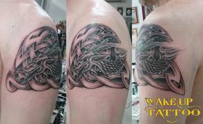 tribal dragon tattoo by Wake up Tattoo Phuket at Patong Beach