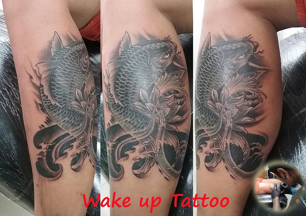 Koi fish Tattoo by Wake up Tattoo Phuket