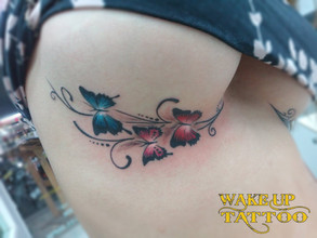 Under chest butterfuly tattoos by Wake up Tattoo Phuket