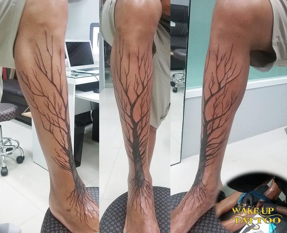 tree and roots tattoo by Wake up Tattoo Phuket