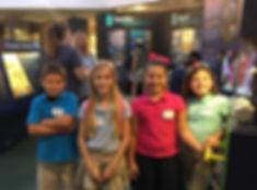 Kids enjoying a visit to Bailey-Matthews National Shell Museum on Sanibel Island Florida