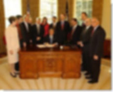 Pic of President Bush in the Oval Office with a group of people