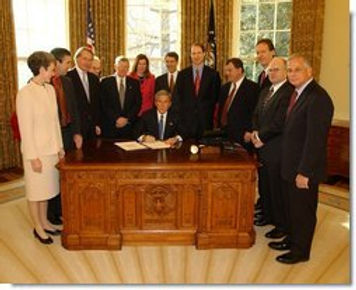 Picture of President Bush Signing CAM-SPAM Act