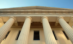 Picture of courthouse columns and portico as seen from below