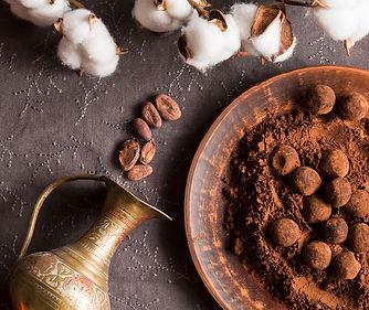 flat-lay-chocolate-truffles-in-cocoa-pow
