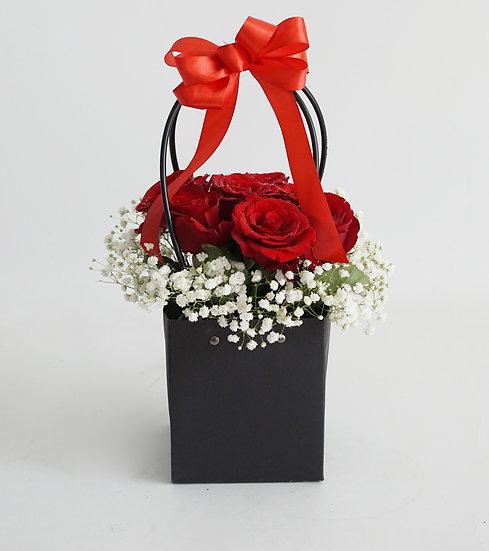 Red Roses in Paper Bag